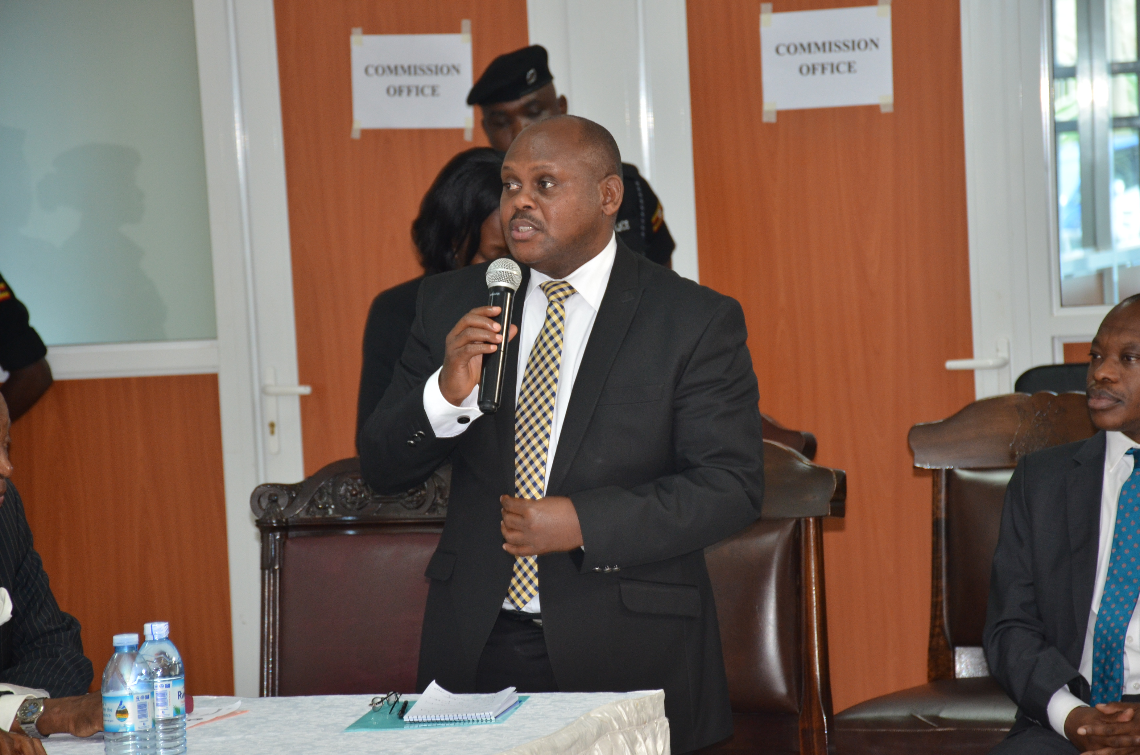 State Minister for Urban Planning Isaac Musumba making his remarks during the launch of the Commission of Inquiry into land matters at the commission's offices at Wandegeya in Kampala.