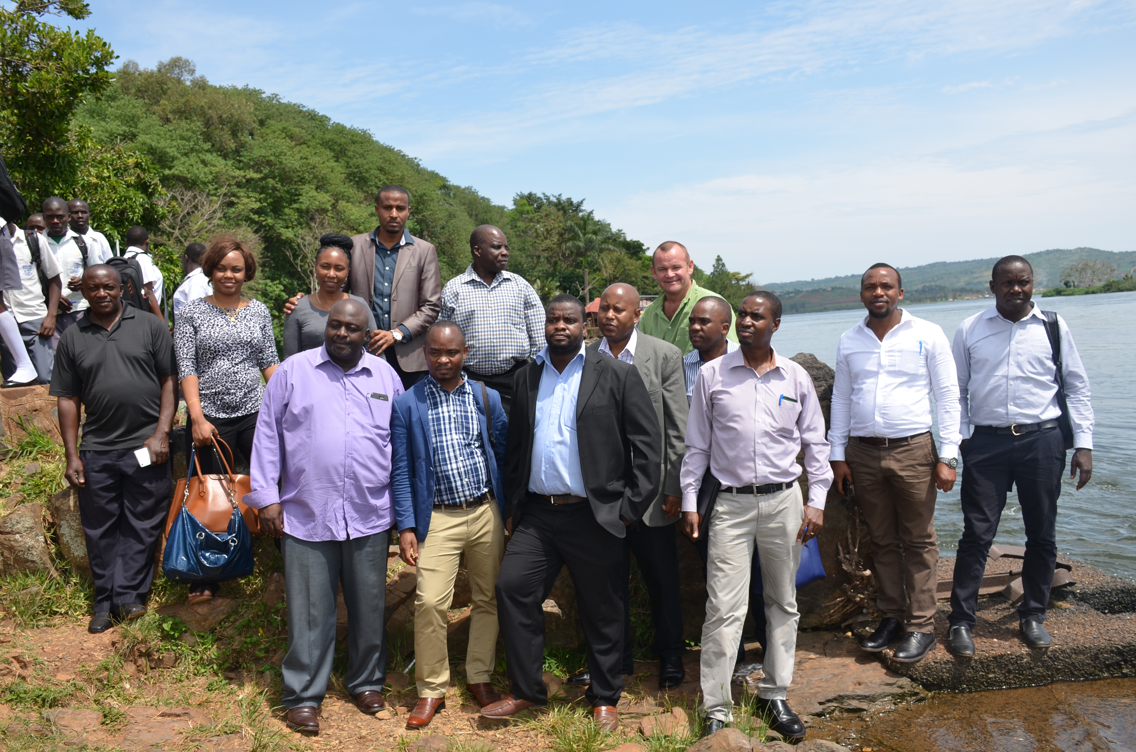 The Tanzanian delegation pose for a group photo at the Source of the Nile shortly after visiting the Jinja Ministry Zonal Office to see how business is conducted.