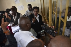 Chairperson of the Commission of Inquiry into land matters Lady Justice Catherine Bamugemereire talking to the PLMO of Wakiso MZO during the Commission's investigations.