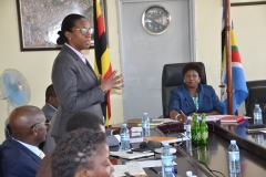 Judy Rugasira Kyanda pledging her committment to the Surveyors Registration Board shortly after being sworn in as the Board's Chaiperson by the Senior Minister.
