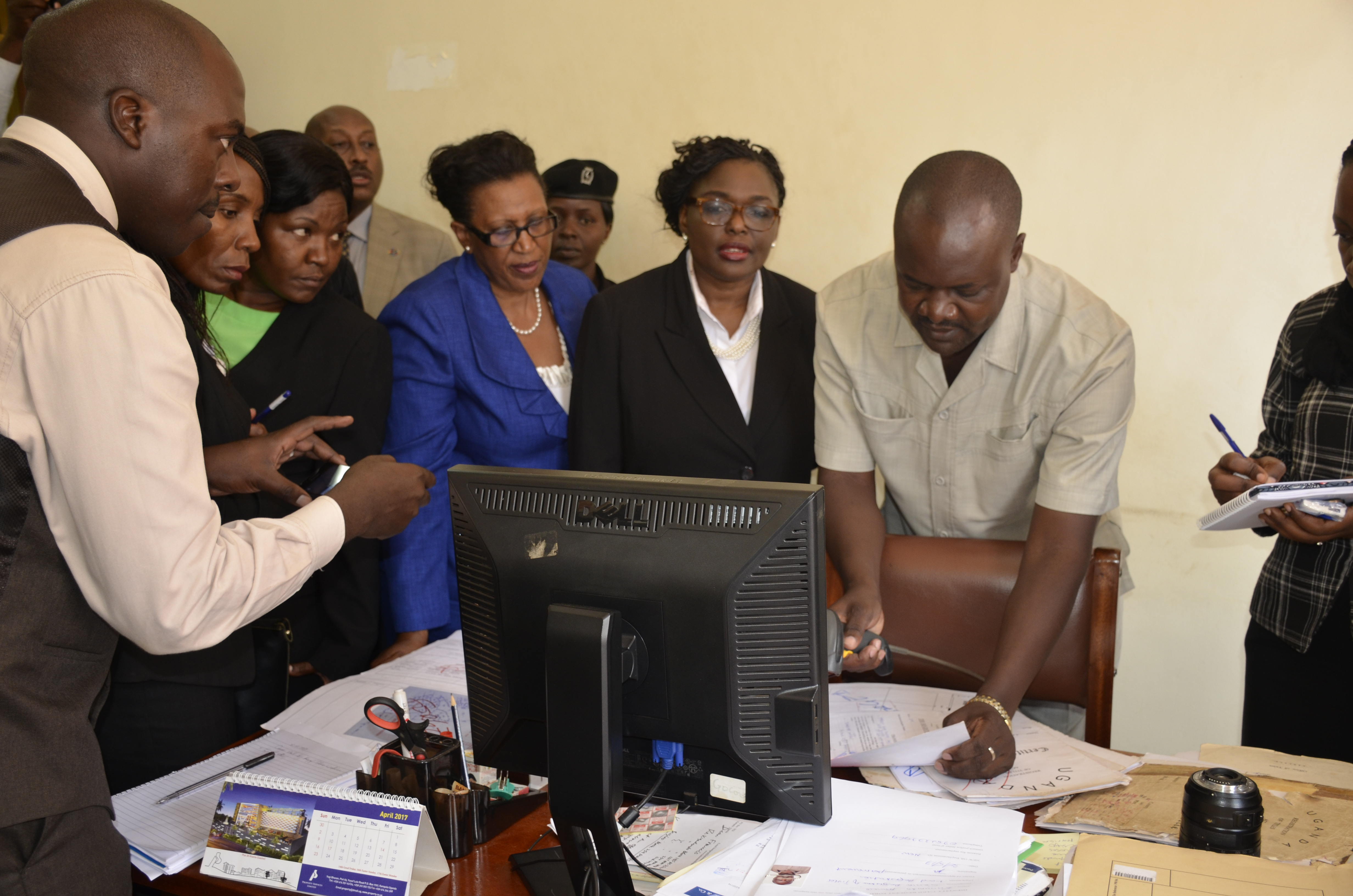 The Registrar of Titles at the Wakiso MZO showing the Commission of inquiry into land matters how to tell a fake title.